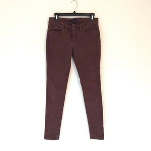 Levi's rust colored skinny jeans
